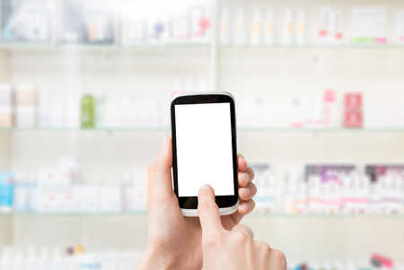 blank screen: screen phone pharmacy smart hand blank mobile background white store medical business medicine shelf pharmacist blurred concept - stock image