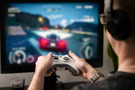 gamepad: gaming game play tv fun gamer gamepad guy controller video console playing player holding hobby playful enjoyment view concept - stock image Stock Photo
