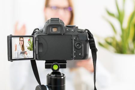discus: blog video camera vlog blogger recording blogging makeup internet girl person photo concept - stock image