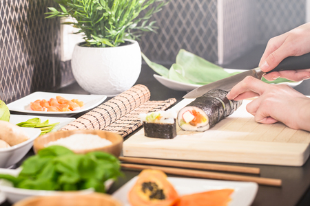 sushi chef cooking japan japanese cuisine kitchen plating hand roll sashimi seafood dish fresh plate food maki concept - stock image