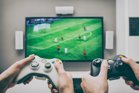 gaming game play tv fun gamer gamepad guy controller video console playing player holding hobby playful enjoyment view concept - stock image Archivio Fotografico