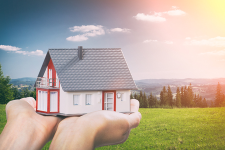 housing house hand real home concept holding loan agent - stock image Archivio Fotografico