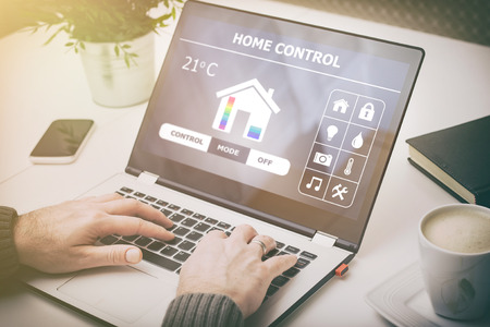 temperature controller: home smart system automated connection room thermostat control display monitoring laptop house remote internet light app technology concept - stock image