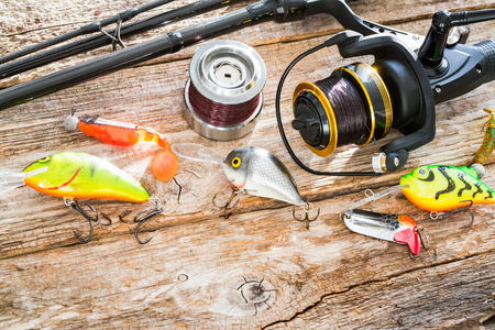 fishing background angler wobbler spinning bait gear rod concept - stock image Stock Photo