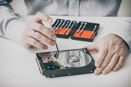engineering tool: data hard drive backup disc hdd disk restoration restore recovery engineer work tool virus access file fixing failed profession engineering maintenance repairman technology concept - stock image