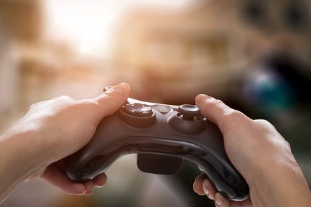 gaming game play tv fun gamer gamepad guy controller video console playing player holding hobby playful enjoyment view concept - stock image Stock Photo