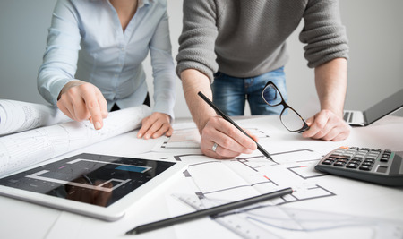 project plan: architects architect project interior design designer planning people architecture drawing business plan construction sketch house concept - stock image Stock Photo