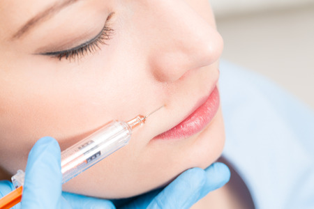 injection woman fillers spa facial young treatment syringe injecting injection skin lips concept - stock image Stock Photo