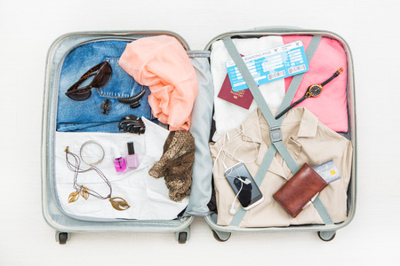 travel traveler traveling bag top open view packing card camera packed credit wallet clothing table leaving departure concept - stock image Zdjęcie Seryjne - 74151953