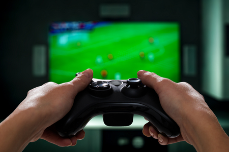 tv station: gaming game play tv fun gamer gamepad guy controller video console playing player holding hobby playful enjoyment view concept - stock image Stock Photo