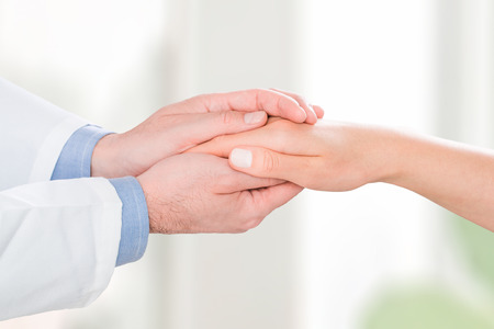 doctor patient care holding human hand trust touch medical thanks help clinic health concept - stock image Banque d'images