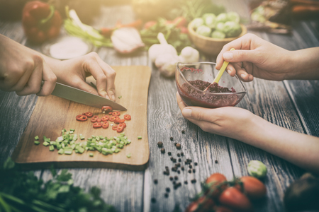 cooking healthy lifestyle meal prepare food women life dinner vegan kitchen live diet hands salad chef happy concept - stock image Banque d'images