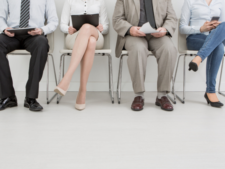 recruitment recruiting hire recruit hiring recruiter interview employment job human room stress stressful position young group formal work chair corporation corporate sitting concept - stock image Banque d'images