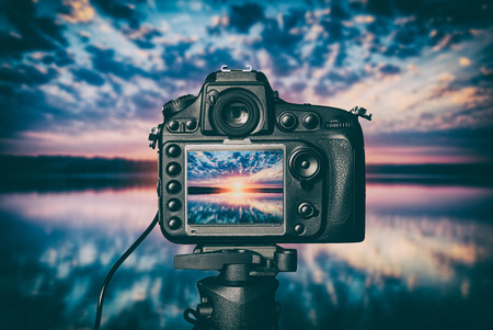 photography view camera photographer lens lense video photo digital glass blurred focus landscape photographic color concept sunset lake water vacations sunrise sun light sky cloud - stock image