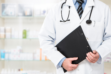 doctor pharmacist medication pills patient practitioner pharmacy tablet sickness clinic drugstore medicine equipment specialist form professional concept - stock image Stock Photo