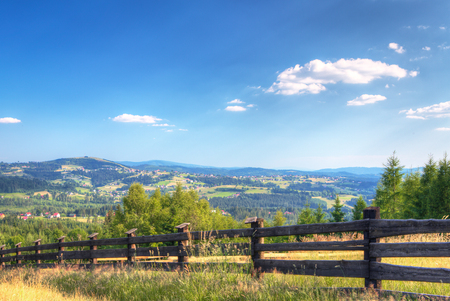 Summer mountains green grass and blue sky landscape Stock Photo