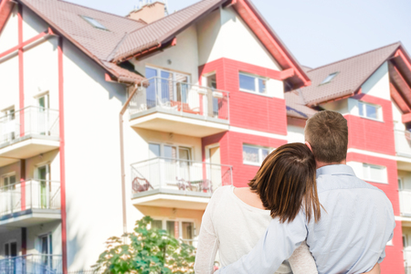 Loving young couple looking at dream house. photo