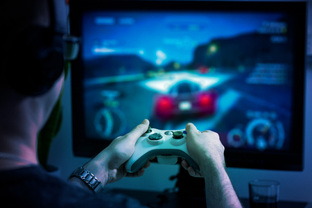 gaming game play tv fun gamer gamepad guy controller video console playing player holding hobby playful enjoyment view concept - stock image Banque d'images