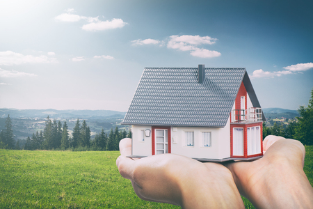 housing house hand real home concept holding loan agent - stock image Standard-Bild