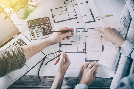 modern interior: architects architect project interior design designer planning people architecture drawing business plan construction sketch house concept - stock image Stock Photo