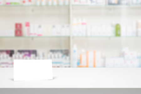 store shelf: counter blank background white store medical table pharmacy business shelf blurred drug shop drugstore medication card concept - stock image
