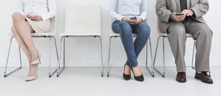 recruitment recruiting hire recruit hiring recruiter interview employment job exam room stress stressful position young group formal work chair corporation sitting diversity concept - stock image photo