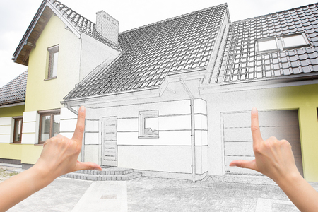 Female hands framing custom house design. Combination drawing and photo. Stok Fotoğraf