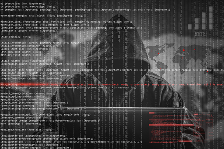 cybercrime: Hacker using laptop. Lots of digits on the computer screen.