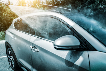 Manual car wash with pressurized water in car wash outside.
