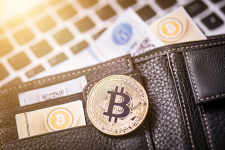 Virtual currency wallet. Bitcoin gold coin and printed encrypted money with QR code. Cryptocurrency concept. Stock Photo
