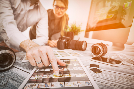 photographer journalist camera snapshot traveling teamwork team man male workroom woman female photo dslr editing edit hobbies lighting business designer concept - stock image
