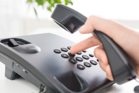 hotline: Communication support, call center and customer service help desk. Using a telephone keypad.