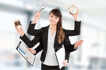 Multitask business woman with many hands. Performing several actions at the same time.