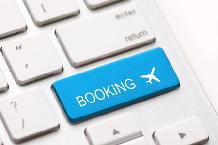 flight booking keyboard plane travel fly check buy website e-ticket key business concept - stock image