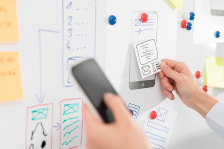 Designer woman drawing website ux app development. User experience concept. 写真素材
