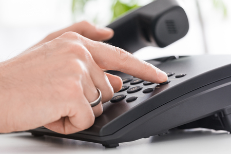 Communication support, call center and customer service help desk. Using a telephone keypad.  Stock fotó