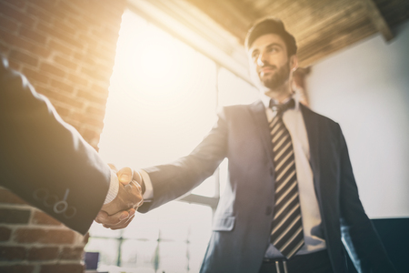 Business people shaking hands, finishing up meeting. Successful businessmen handshaking after good deal. Reklamní fotografie