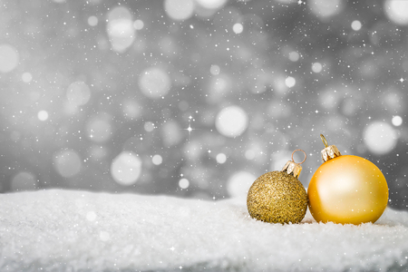 snow background closeup decoration white christmas golden gold space snowflakes bauble ball horizontal copy space nobody xmas glitter concept - stock image