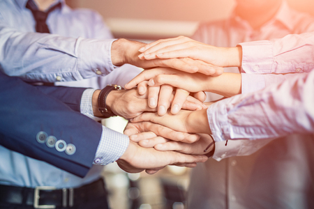 Close up top view of young business people putting their hands together. Stack of hands. Unity and teamwork concept. 免版税图像 - 89642785