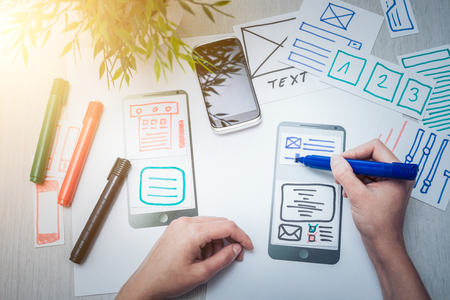 Designer woman drawing website ux app development. User experience concept. Stock Photo