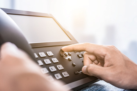Communication support, call center and customer service help desk. Using a telephone keypad.  Banque d'images