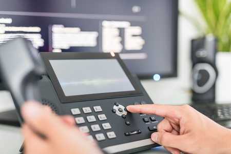 Communication support, call center and customer service help desk. Using a telephone keypad.  Stockfoto