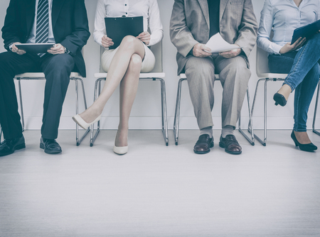 recruitment recruiting hire recruit hiring recruiter interview employment job exam room stress stressful position young group formal work chair corporation sitting diversity concept - stock image Stock Photo