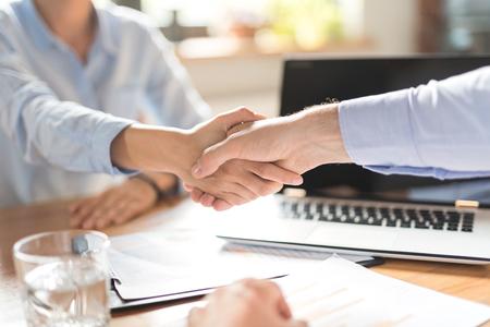 Business people shaking hands, finishing up meeting. Successful businessmen handshaking after good deal. Standard-Bild