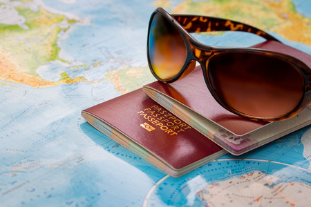 travel passport map holidays  tourism booking sunglasses plan tourist trip world glasses summer worldmap visit concepts sanctions concept - stock image