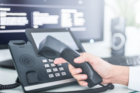 Communication support, call center and customer service help desk. Using a telephone keypad.  Banco de Imagens