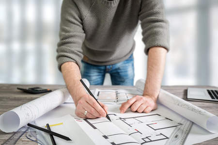 architect architecture drawing project designer blueprint office business working architectural construction design work ruler table workplace people concept - stock image Stock Photo