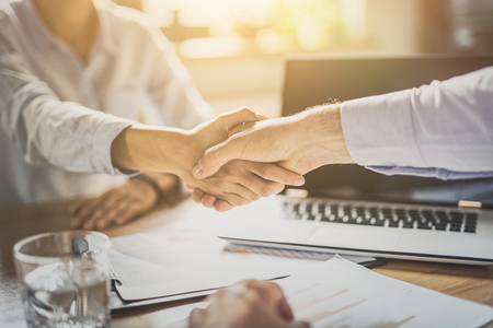Business people shaking hands, finishing up meeting. Successful businessmen handshaking after good deal. Archivio Fotografico