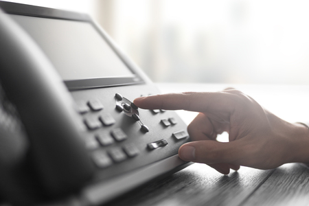 Communication support, call center and customer service help desk. Using a telephone keypad.  Stock Photo