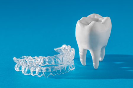Inivisalign braces or aligner. A way to have a beautiful smile and white teeth. Stock Photo